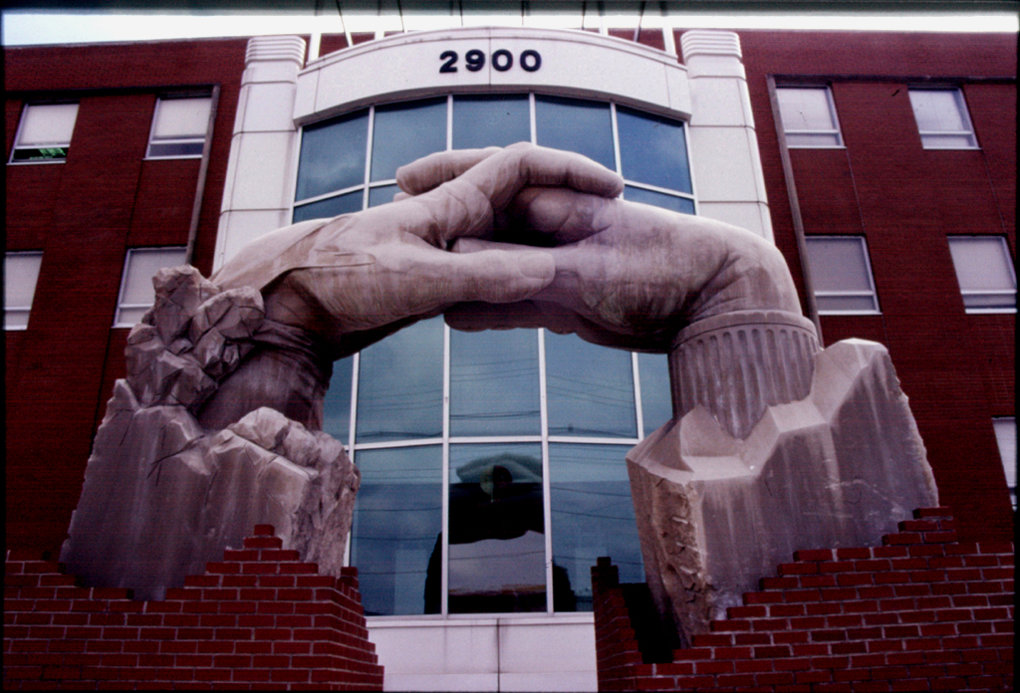 Opportunity Portal  Meg White Sculpture Studios, Inc. ©2000 15'H x 20'L x 5'W Indiana Limestone Two hands, one representing the community and the other representing the  Nia Center, come together to create the Opportunity Portal.